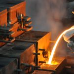 Pouring molten grey iron into sand mold